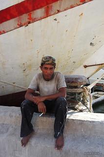 Worker on break - Sunda Kelapa port - Jakarta   by -AX-
