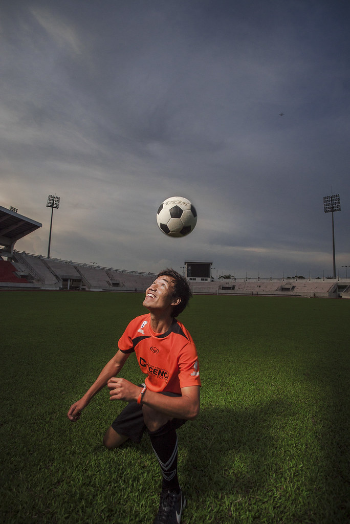 Sports Friends coach Kim hedading a football