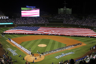 A giant American flag is unfurled at Wrigley Field before World Series Game 3. | by apardavila