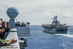 Sailors aboard USS Green Bay (LPD 20) observe as USS Bonhomme Richard (LHD 6) breaks away from a formation last week during exercise Valiant Shield. (U.S. Navy/MC3 Patrick Dionne)