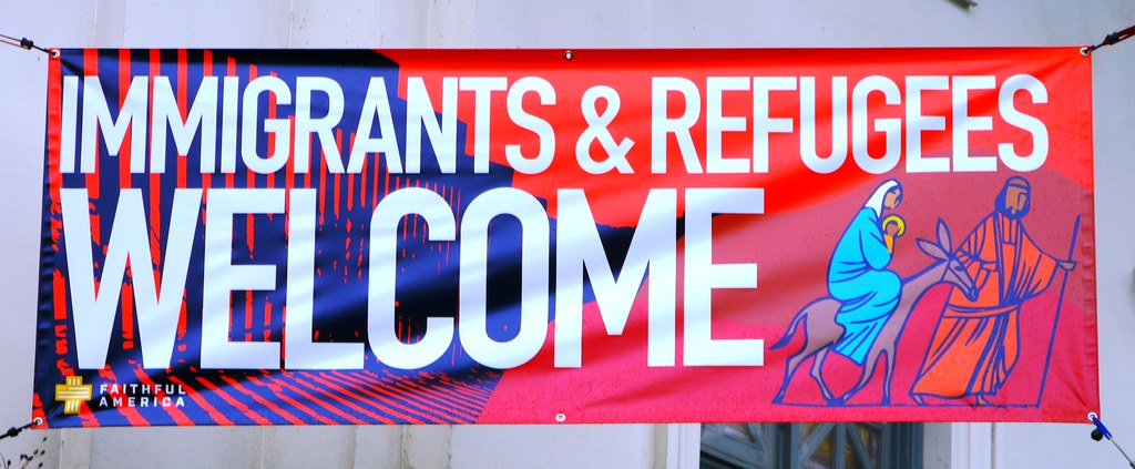 Immigrants & Refugees Welcome Sign