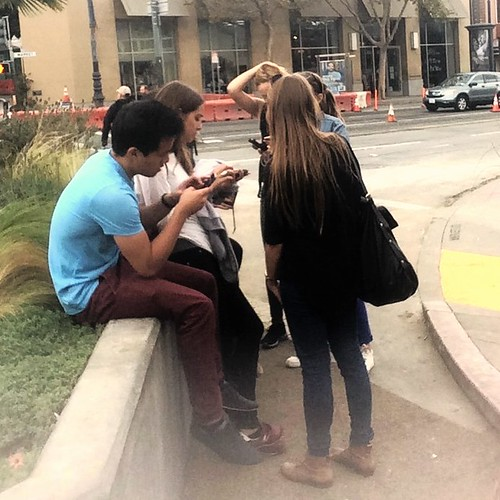 Teens Together Staring At Their Cell Phones | by Lynn Friedman