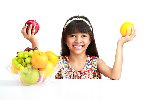 Little asian girl with fruit