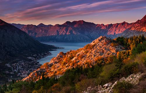 kotor montenegro adriatic lake bay mountains sunset clouds sky landscape rocks trees