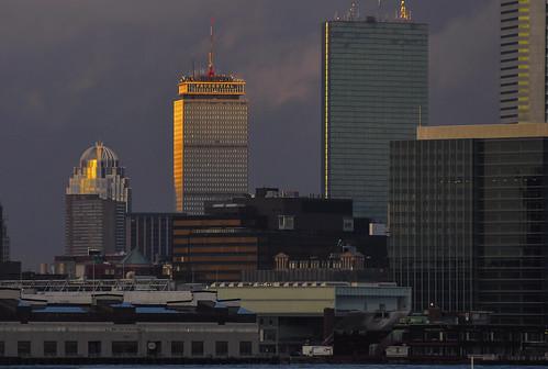 reflection boston skyline architecture sunrise hancocktower prudentialbuilding bostonskyline bostonharbor