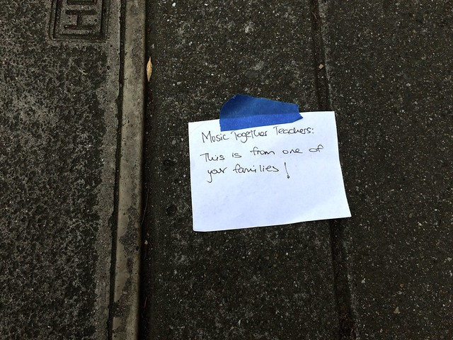Inexplicable Sign Taped to Sidewalk says