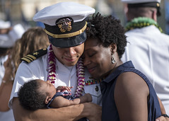 Lt. Cmdr. Joseph Edwards is greeted by his wife and child following the return of USS Greeneville (SSN 772). (U.S. Navy/PO2 Michael H. Lee)