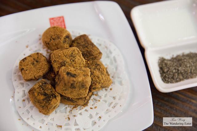 Brown sugar mochi with coocnut cream and black sesame powder to dip