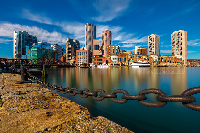Golden Morning Light over Downtown Boston Skyline and Harbor with Nautical Chain - Fan Pier Harborwalk South Boston Massachusetts