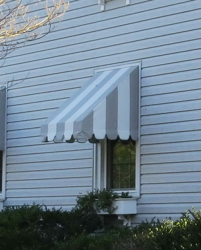 Window Awnings with Flower Boxes