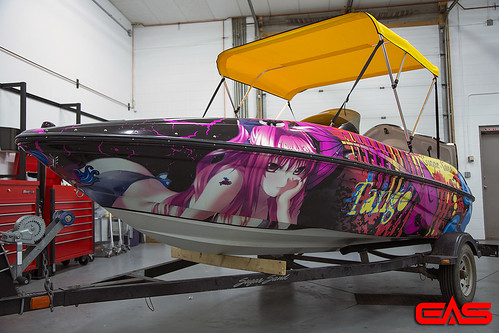 Printed vinyl can withstand harsh environments, making even boat hull wraps possible. | by eliteautosalon719