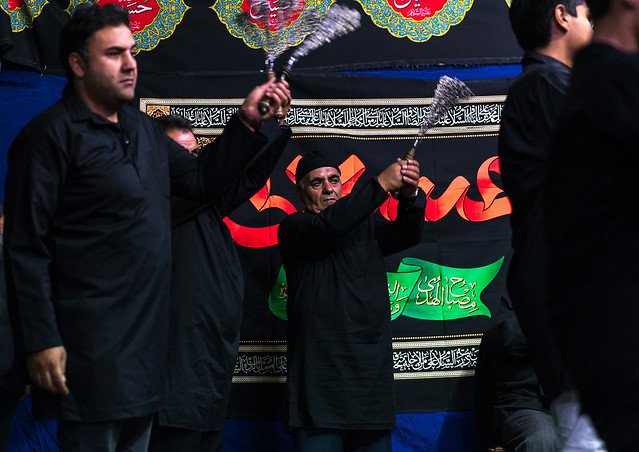 Iranian shiite muslim men beating themselves with iron chains to commemorate ashura, Central county, Theran, Iran