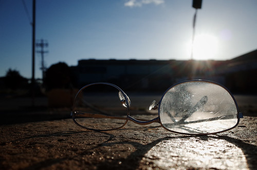 city blue sunset sky urban sun sunlight canada detail broken glass sunshine lens found glasses evening bc britishcolumbia richmond clear specs sunburst fading discarded scratched spectacles foundobject ricohgr fragment riverdrive