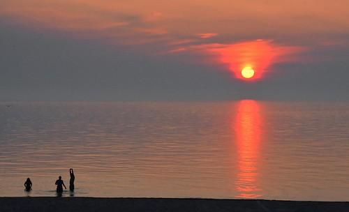sunset people usa sun lake seascape reflection beach silhouette clouds swimming landscape evening nikon michigan lakemichigan sawyer swimmers shorewood 18200mm stevelamb d7200