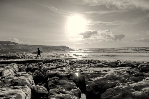rest bay porthcawl wales welsh glamorgan cymru winter sunshine surf surfing sunset evening reflections light haze weather surfboard restbay seaside sea waves swell