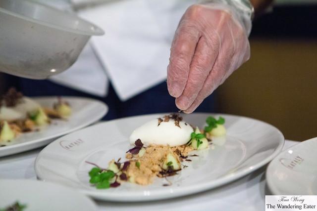 Chef sprinkling the shaved black truffle on top of the Grana Padano gelato