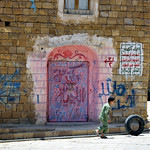 Boy, tire, and graffiti