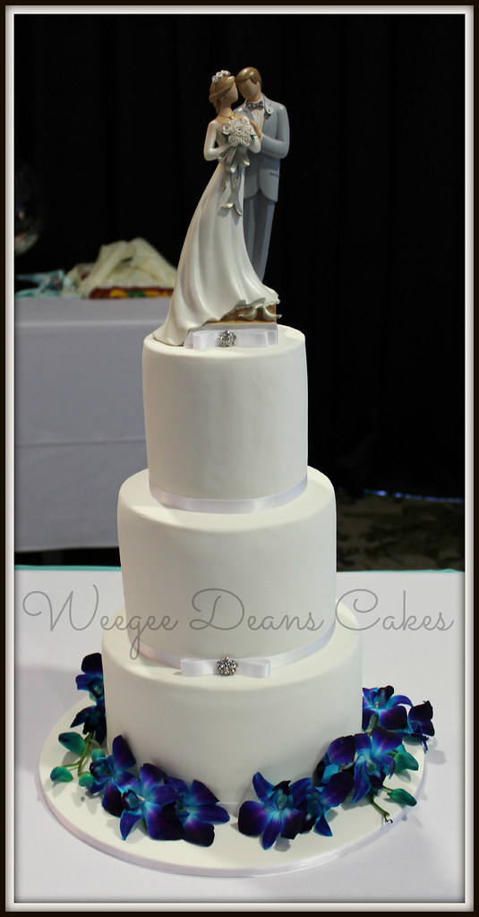 Simple 3 tier wedding cake with fresh orchids