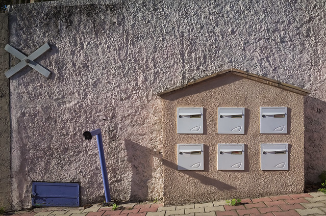 6 letterboxes set in a hut