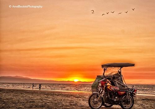 sunset orange beach sand warm tricycle