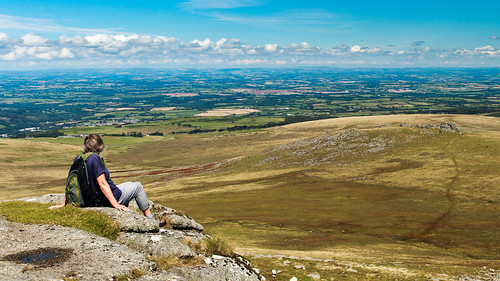 devon dartmoor tor yestor westmilltor nationalpark landscape person sitting hiker hilltop vista panorama view outdoor moorland farming granite rock