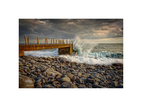 madeira atlantic atlanticocean riesmagos pier rocks seashore seascape boulders sunset sunlight waves splash johnbaker d750