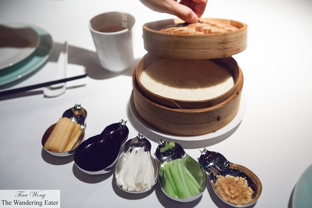 Our Peking duck condiments and steamer basket of flour pancakes