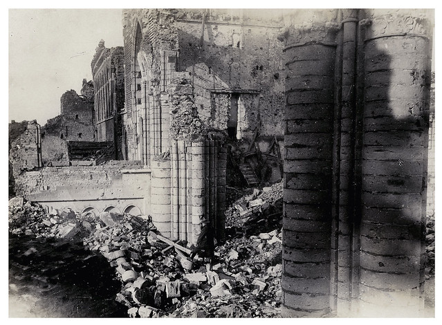 New Zealand Soldier among the ruins of the St Martin's Cathedral, Ypres, Belgium 1917 - Archives New Zealand Te Rua Mahara o te Kāwanatanga