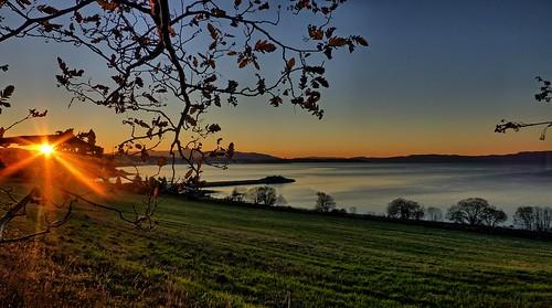sunset green field fjord trondheim væretrøa