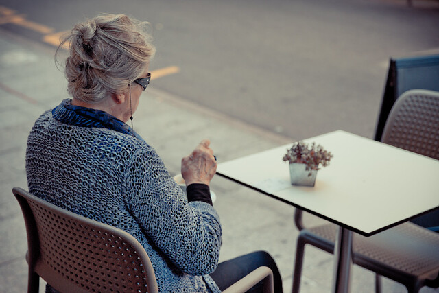 Lonely old woman having a coffee [Explored]