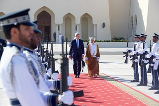 Secretary Kerry and Omani Foreign Minister bin Alawi Walk Through an Honor Guard