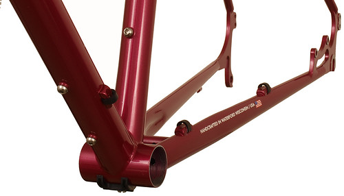 <p>Chainstay detail of a Gunnar Cycles' Grand Disc fully the supports the loaded tourer with durable construction, double rear eyelets, three sets of water bottle bosses.  The comfort fit makes every mile a pleasure to ride.  Shown here in Rosewood Metallic.</p>