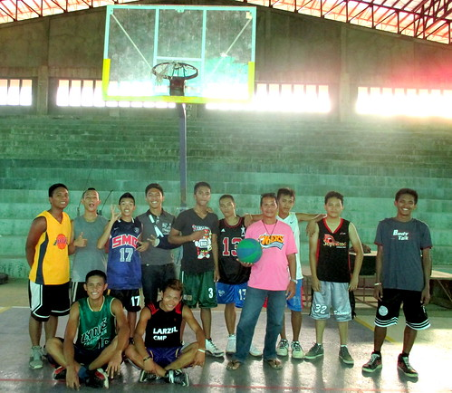 Coach Pedro gathers with local basketball players for a photo in the newly-rehabilitated Naval Civic Center - July 2015. | by dilg.yolanda
