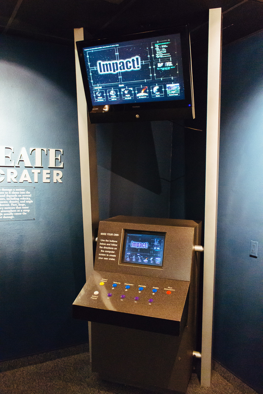 Interactive museum exhibit with two screens and buttons