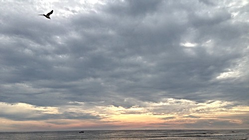 mostly cloudy breezy sunset sanibel florida swfl sky water blue beach sea gulf weather erkohl er kohl