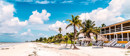 florida usa beach blue clouds empty fortmyersbeach heat nature nopeople ocean outdoors pacific palmtrees sand scenic sky sunshine travelling tropical