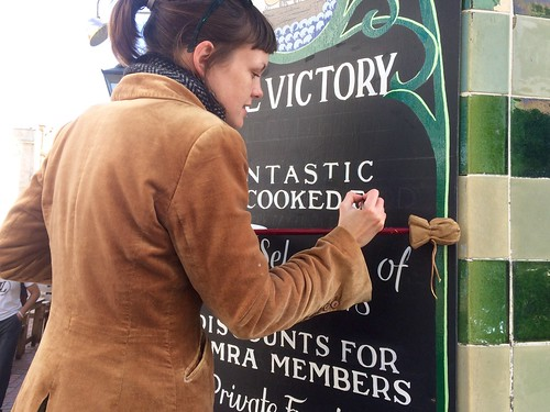Sign painting outside The Victory. | by adactio