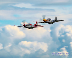 TWO P-51S AGAINST THE CLOUDS