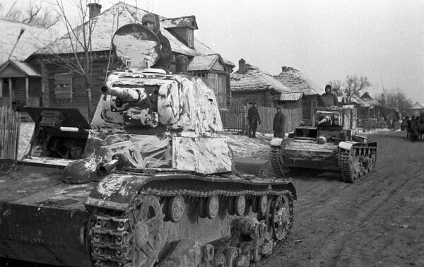 T-26 tanks in a village in Russia (1941)