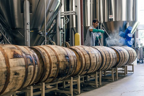 Zach filling bourbon barrels for Curieux. | by Allagash Brewing