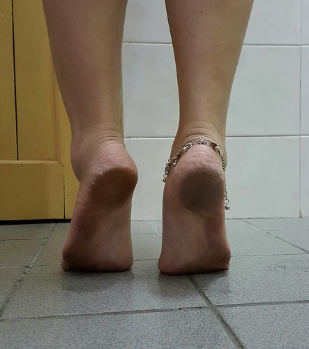 Tiptoes with dirty soles