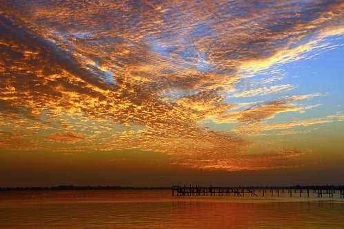 blue sky orange colors sunrise dock downtown colorfull stuart boardwalk floridawater