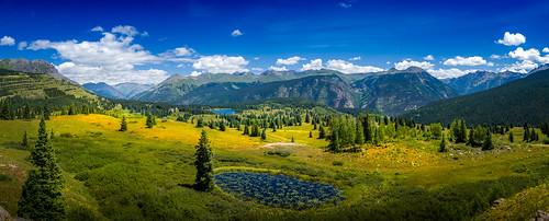 blue sky panorama mountain mountains forest landscape pond colorado pano meadow sanjuan co rockymountains milliondollarhighway