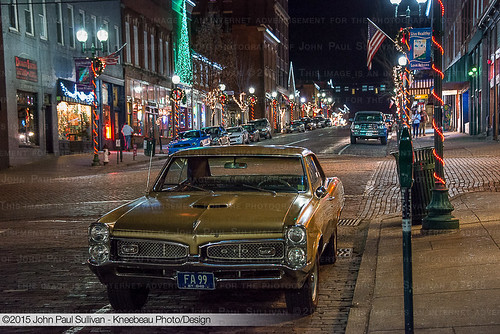 1967 Pontiac GTO parked uptown with Christmas Lights at nightime