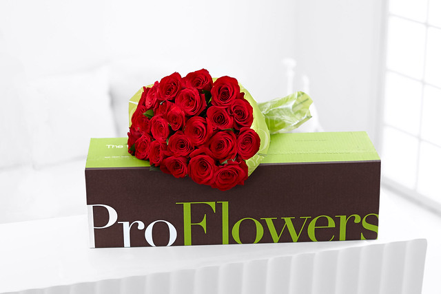 red rose bouquet on top of ProFlowers box
