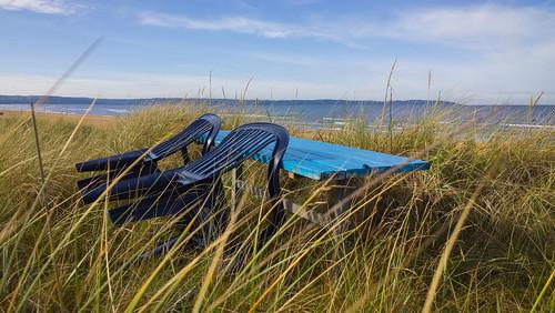 ocean sky beach grass bench landscape sand chairs sweden outdoor dune mellbystrand laholmsbukten hallandslän