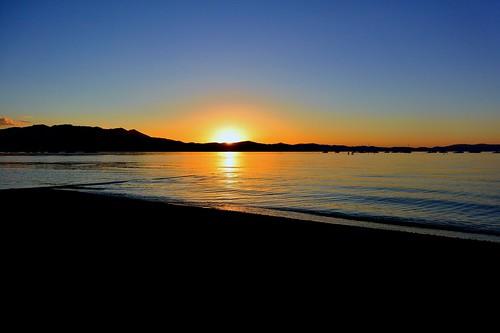 california blue sunset orange mountain lake sand laketahoe alpine sierranevada southlaketahoe inyonationalforest joelach