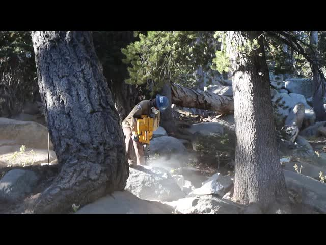 337 LOUD video of a California Conservation Corps worker with a gas-powered rock drill on a granite boulder