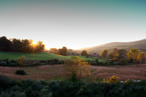sunset sunburst field mountains sky hay trees color fall autumn