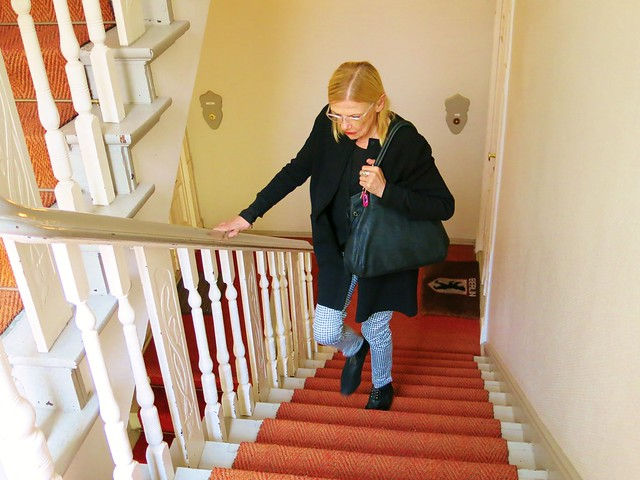 going upstairs in the schröderstrasse. the stairs to david bowie's apartment had the same red carpet.